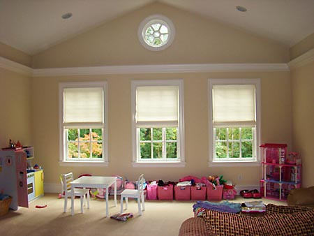 3 windows with roman shades installed