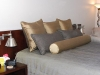 gold pillows on a bed