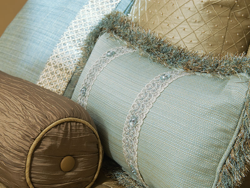 blue-brown-pillows-with-cut-trim-and-flat-trim-cording