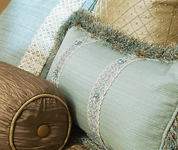 detailed close-up photo of custom hand-made pillows on a bed