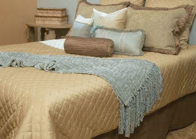 bed-detail-with-pillows-and-scaldino
