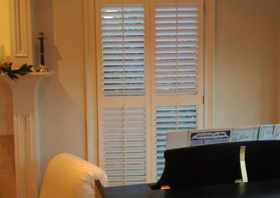 wood shutters with arch window above
